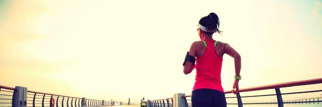 woman running on pier at seaside