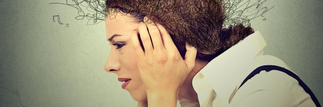 side profile of stressed woman holding her head