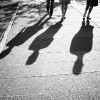 shadows of people on the street