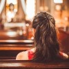 young woman sitting in a church