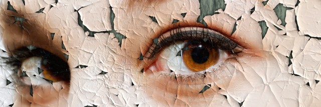 cracked photo of a woman's eyes