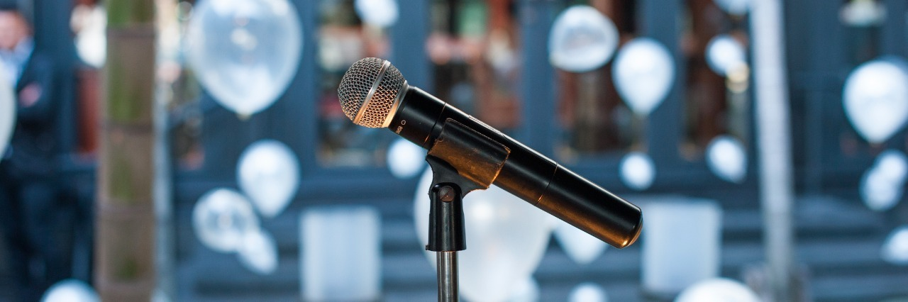 microphone on stand with wedding decorations in the background