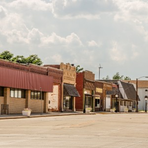 Downtown in a small town in Oklahoma with buildings of various ages and architectural styles.