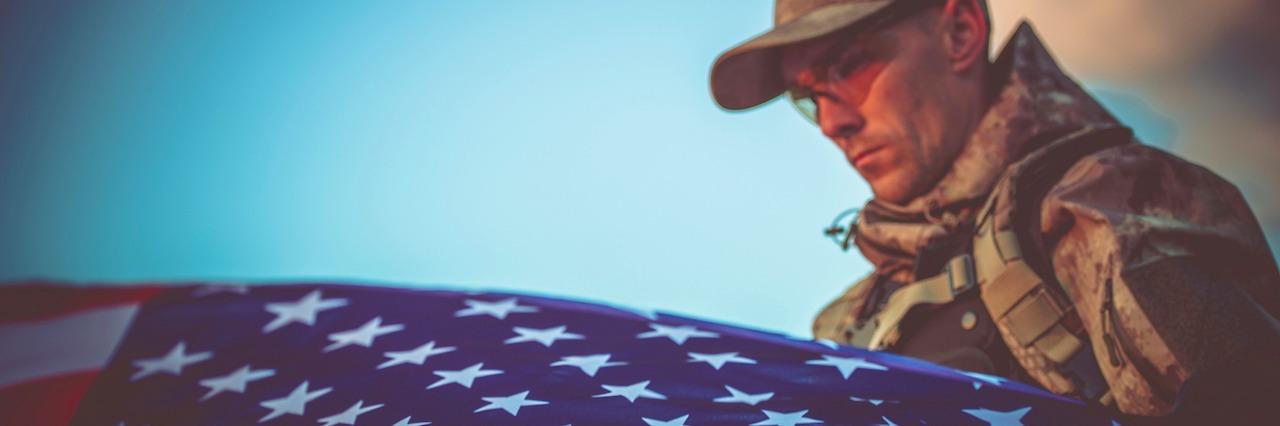 veteran holding an American flag