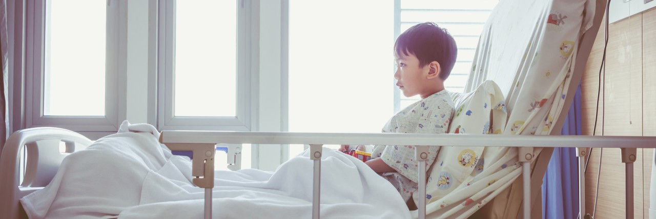 Child in a hospital bed.