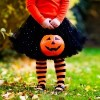 girl dressed in halloween outfit