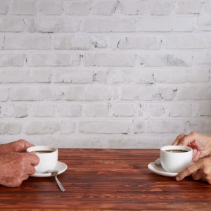 couple sitting in cafe and drinking coffee