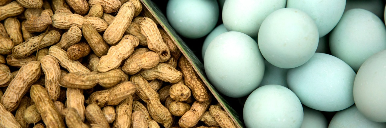 peanuts in shells and eggs next to each other