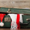 Suitcase with holiday hat and scarf.