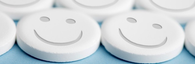 pills with smiley faces on them