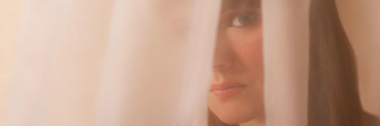 Woman behind a veil