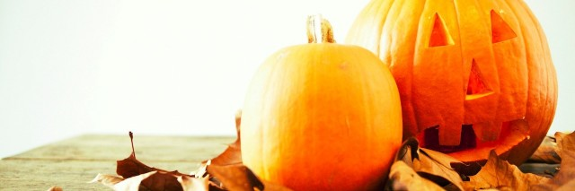 pumpkins and crushed leaves on the table
