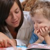 Mom reading son bedtime story