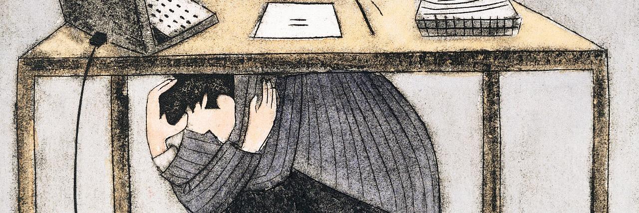 Businessman hiding under a desk