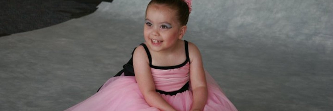 little girl with cerebral palsy in a ballerina costume