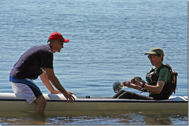 two men on a boat in a lake