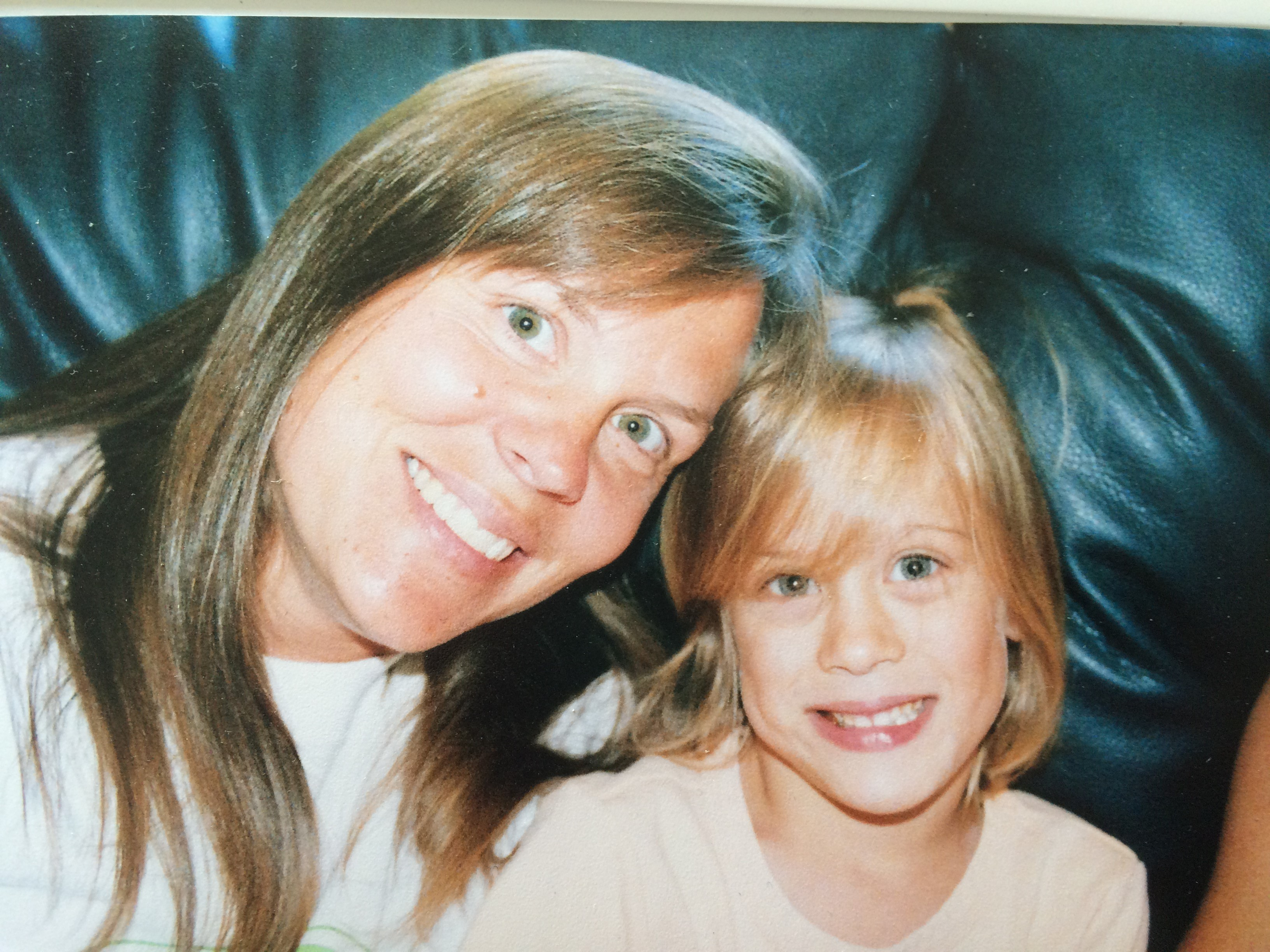 mom and daughter smiling