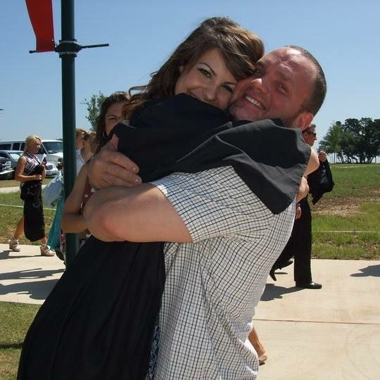 The author hugging his daughter at her graduation.