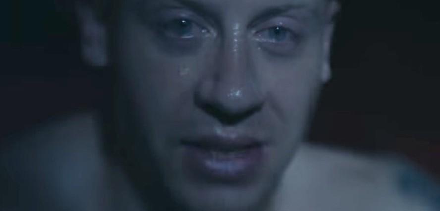 screenshot from macklemore drug dealer video