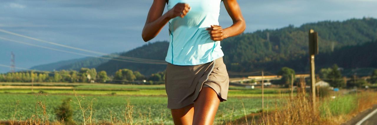 woman jogging on path outside