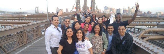 group of people standing on a bridge
