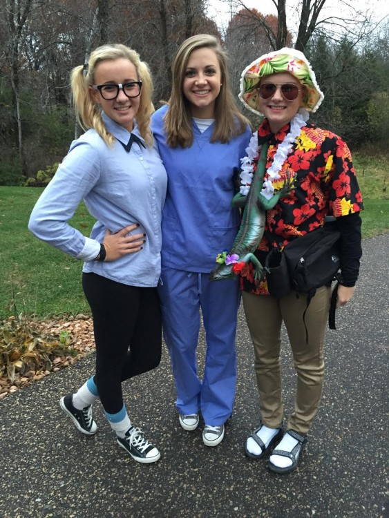 three friends dressed up as a nerd, a doctor and a tourist to go trick-or-treating on halloween