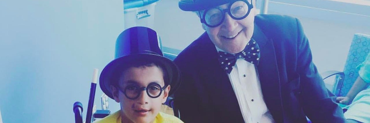 young boy and older man in top hats