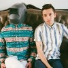 the two members of Twenty one pilots sitting on a couch