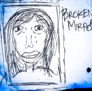 a self-portrait of the author with the words: Broken Mirror