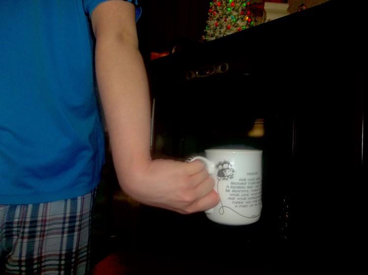 wrist bending the wrong way holding a mug of coffee