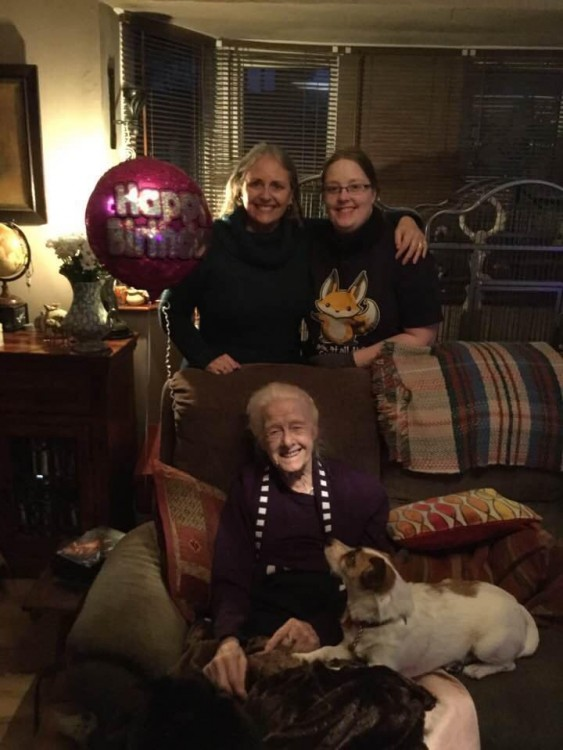 grandmother, mom and daughter by couch at party