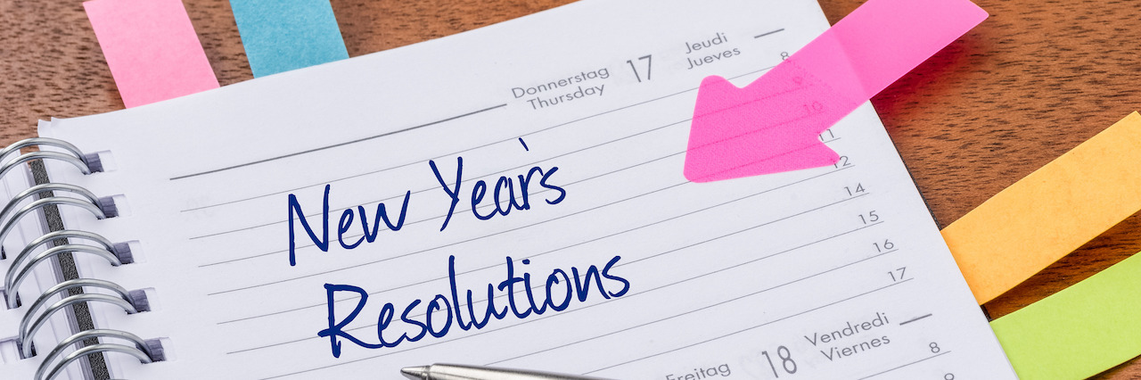 Daily planner with the entry New Years Resolutions