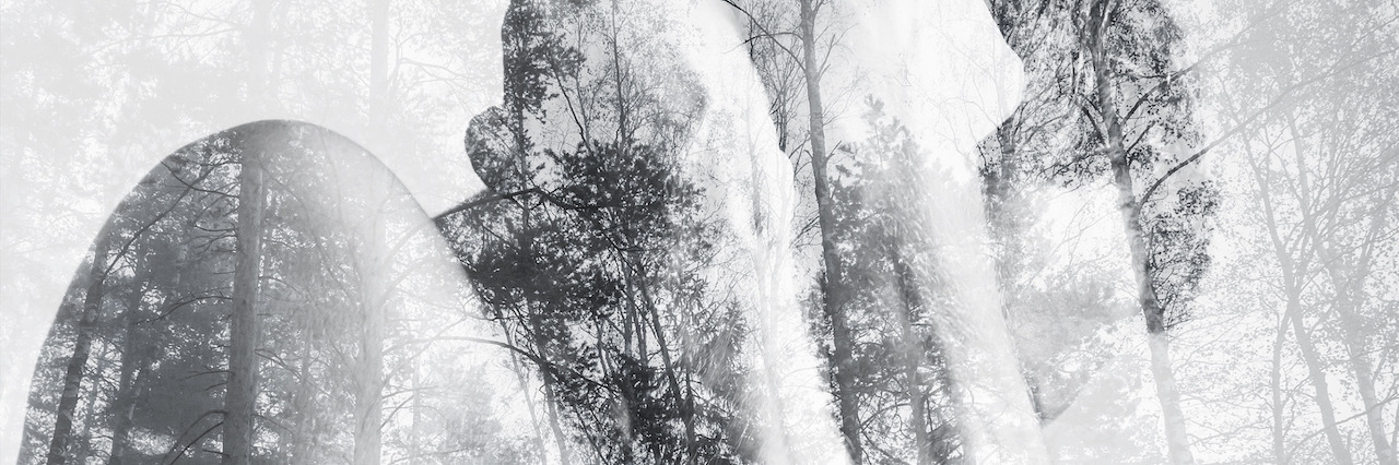 Strong young man hides behind his blocking hands, double exposure photo combined with wild forest landscape