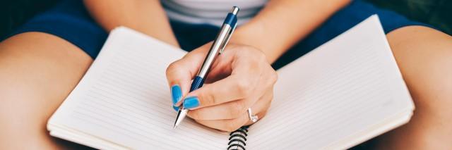 Notebook on women's hand