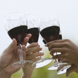 friends with glasses of wine toasting