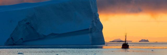 Ship close to an iceberg.