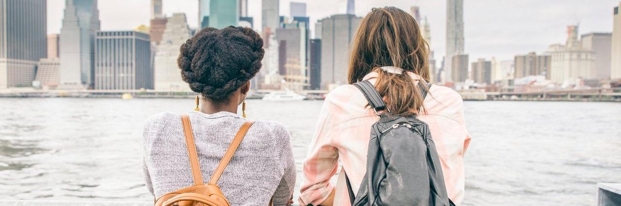 women looking at New York skyline