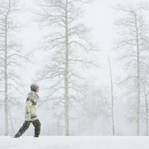 woman walking through the snow