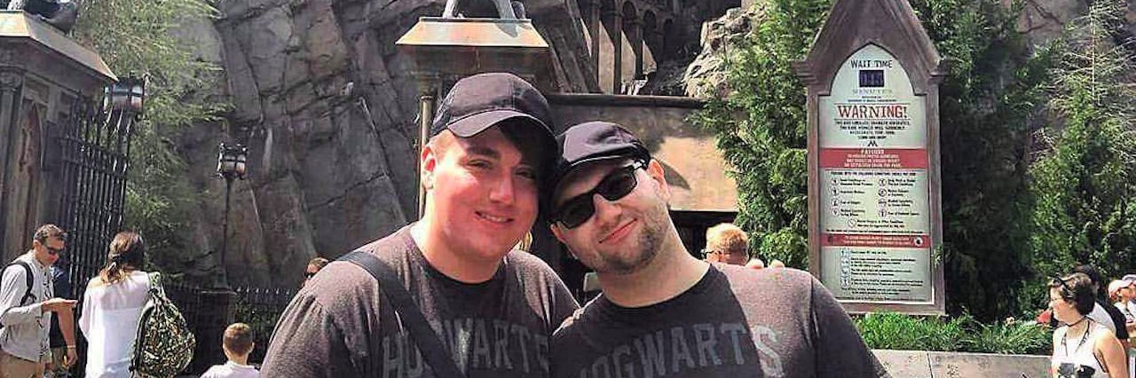 two men at the wizarding world of harry potter
