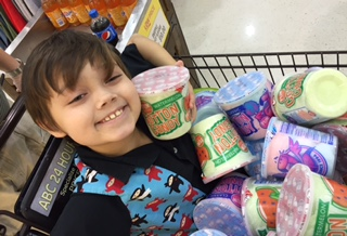little boy in shopping cart of cotton candy