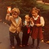an old picture of the author and her two little brothers