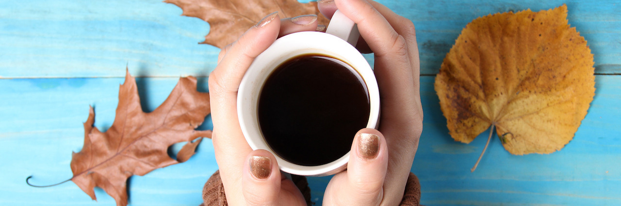 Woman hands holding cup of coffee