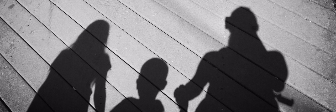 shadow of family holding hands