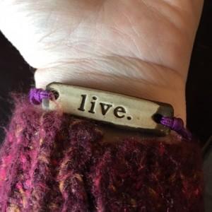 bracelet that says 'live'