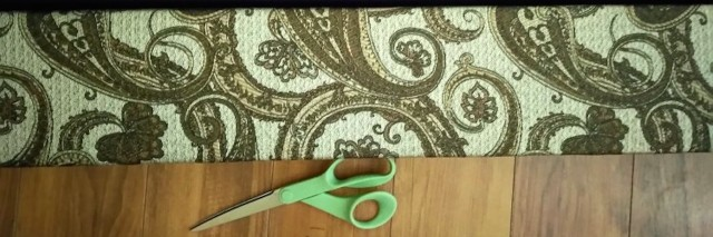 fabric and scissors lying on a wood floor