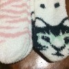 fuzzy socks with pink zebra stripes and cats