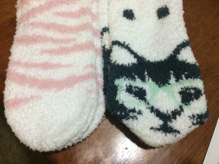 fuzzy socks with pink zebra stripes and cats