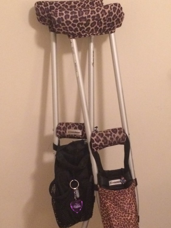 crutches decorated with leopard print fabric