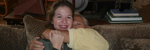 young woman hugging her grandfather