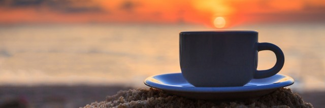 Coffee cup and sunset
